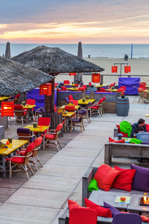 scheveningen: The Hague, Netherlands - April 21, 2016: beach bar at the beach of Scheveningen. Scheveningen is a district of The Hague and is famous for its long beach, esplanade and pier Editorial