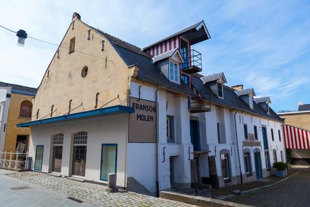 limburg: Valkenburg, Netherlands - April 11, 2016: historical watermill in the old town of Valkenburg. Valkenburg aan de Geul in the province Limburg is a popular tourist destination