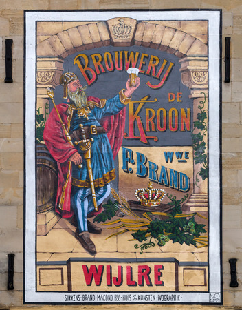 limburg: Valkenburg, Netherlands - April 11, 2016: historical beer advertisement at a house wall in Valkenburg. Valkenburg aan de Geul in the province Limburg is a popular tourist destination