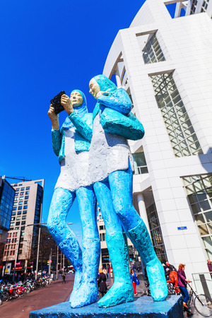The Hague, Netherlands - April 21, 2016: sculpture in front of the New City Hall of The Hague with unidentified people. It was designed in 1986 by American architect Richard Meier and completed 1995