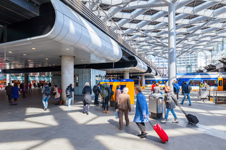 netherlands: The Hague, Netherlands - April 21, 2016: main station with unidentified people. It is the with twelve tracks the largest terminal station in the Netherlands. The station was completed in 1973