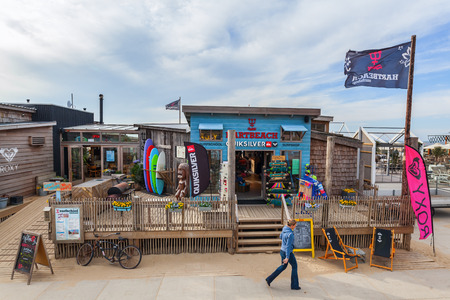 scheveningen: Scheveningen, Netherlands - April 21, 2016: beach bar in Scheveningen with unidentified people. From a small fishing village Scheveningen developed to the largest seaside resort i Netherlands Editorial