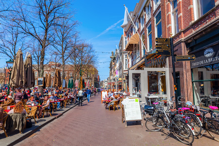 The Hague, Netherlands - April 21, 2016: The -Plein- with unidentified people. The plein is one of the main squares in the city with a lot of street cafes, where the night life is happening.