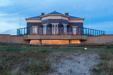 scheveningen: house in the dunes of Scheveningen, Netherlands, at dusk