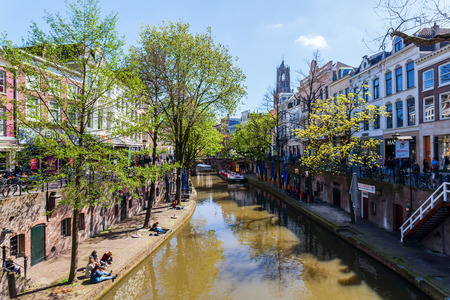 utrecht: Utrecht, Netherlands - April 20, 2016: old town scene at a canal in Utrecht. The university city Utrecht is the 4th largest city of the Netherlands and capital of the same named province