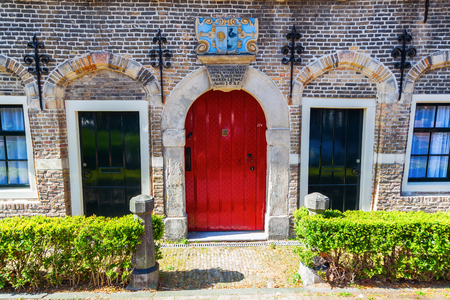 christina: Gouda, Netherlands - April 20, 2016: historical house of the Christina Gijsberts courtyard. In the past existed a lot of small courtyards in Gouda. The most have been lost. Here only the house is left