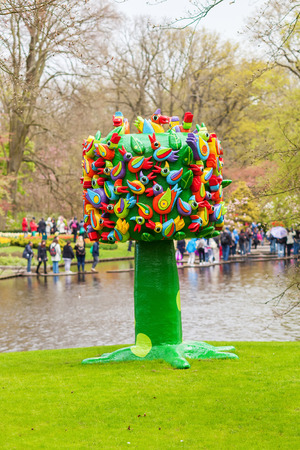 annually: Lisse, Netherlands - April 23, 2016: sculpture at Keukenhof. It is one of the worlds largest flower gardens. Approximately 7 million flower bulbs are planted annually in the park Editorial