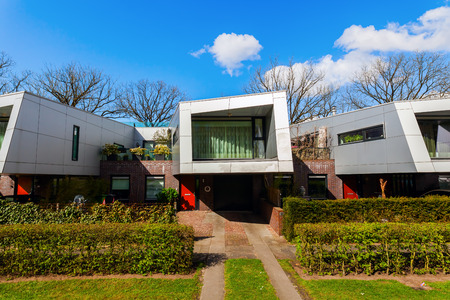 sound proof: Hilversum, Netherlands - April 19, 2016: sound barrier houses called The Cyclops. They are part of a sound proof embankment, designed by NIO architects. Editorial