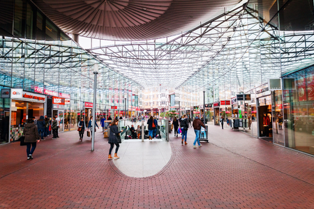 Zoetermeer, Netherlands - April 22, 2016: shopping center Spazio with unidentified people. From villages with 10,000 inhabitants Zoetermeer grew up after 1962 to a city with 100.000 inhabitants 1991