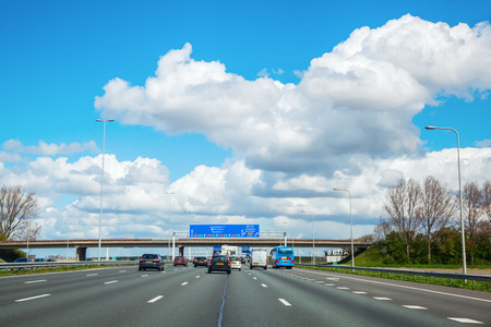 planned: Province South Holland, Netherlands - April 23, 2016: A4 motorway. The A4 is 114 km long and was planned to connect Amsterdam with Brussels. Today there is still a gap of 11 km near Rotterdam