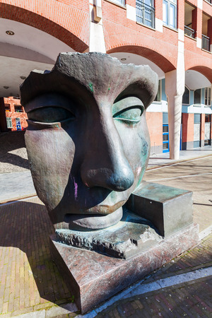 renown: The Hague, Netherlands, April 20, 2016: sculpture Per Adriano from Igor Mitoraj at Muzenplein. Igor Mitoraj is a world renown sculptor, whose works are distributed among the cities of the world