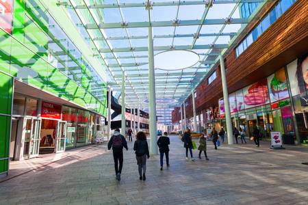 almere: Almere, Netherlands - April 19, 2016: ceiled pedestrian area with unidentified people in Almere, that is a fast planned city. With a population of about 200,000 it is the 7th largest Dutch city Editorial