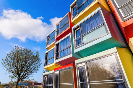 almere: Almere, Netherlands - April 19, 2016: modern stackable student apartments called spaceboxes in Almere. Almere is famous for its extraordinary and experimental architecture