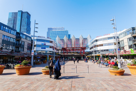 almere: Almere, Netherlands - April 19, 2016: railway station of Almere with unidentified people. Almere is a fast growing, planned city. With a population of about 200,000 it is the 7th largest Dutch city