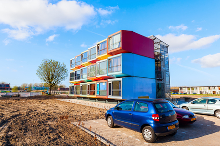 stackable: Almere, Netherlands - April 19, 2016: modern stackable student apartments called spaceboxes in Almere. Almere is famous for its extraordinary and experimental architecture