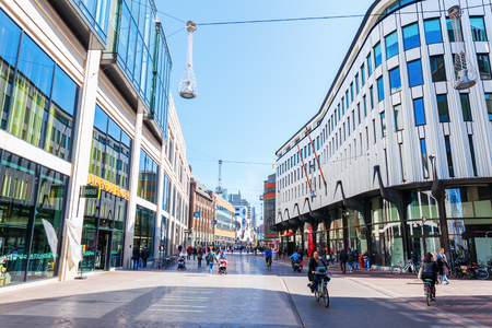 The Hague, Netherlands - April 21, 2016: city street in The Hague, Netherlands, with unidentified people. The Hague is the seat of the Dutch government and the 3rd largest city of the Netherlands