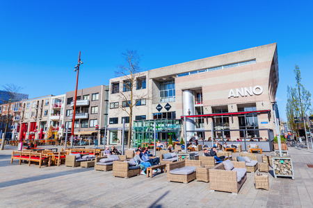 planned: Almere, Netherlands - April 19, 2016: city center of Almere with unidentified people. Almere is a fast growing, planned city. With a population of about 200,000 it is the 7th largest Dutch city