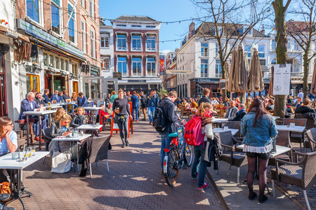 The Hague, Netherlands - April 20, 2016: town square Het Plein with unidentified people. As a town square, Het Plein was constructed in 1632 and was inspired by the Place des Vosges in Paris