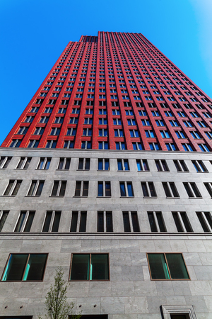 low angles: The Hague, Netherlands - April 20, 2016: skyscrapers in The Hague. The Hague is the seat of the Dutch government and the 3rd largest city of the Netherlands with 515,880 inhabitants
