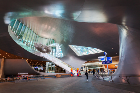 Arnhem, Netherlands - April 19, 2016: Arnhem Central railway station with unidentified people. After reconstruction it was reopened 2015. The new design was by UNStudio