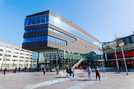 almere: Almere, Netherlands - April 19, 2016: city center of Almere with unidentified people. Almere is a fast growing, planned city. With a population of about 200,000 it is the 7th largest Dutch city