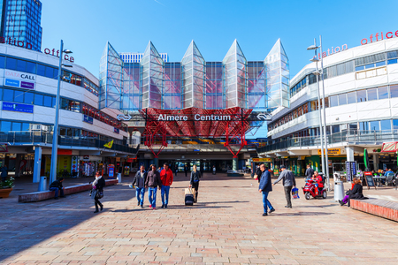 almere: Almere, Netherlands - April 20, 2016: railway station of Almere with unidentified people. Almere is a fast growing, planned city. With a population of about 200,000 it is the 7th largest Dutch city