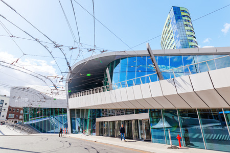Arnhem, Netherlands - April 19, 2016: Arnhem Centraal railw station with unidentified people. After reconstruction it was reopened 2015. The new design was by UNStudio, that won an architecture price