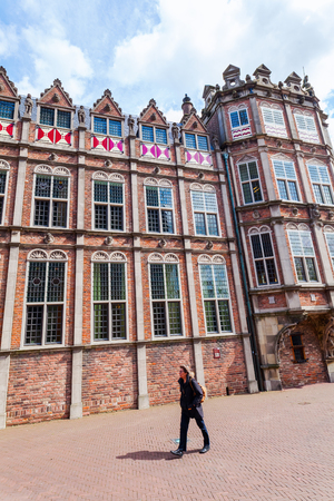 Arnhem, Netherlands - April 19, 2016: House of the Devil with unidentified people. It is a history-charged building that houses today a part of the city hall Sajtókép