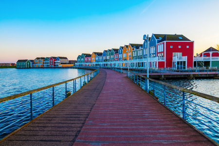row of houses: colorful row houses in Houten, Netherlands, at dusk Stock Photo