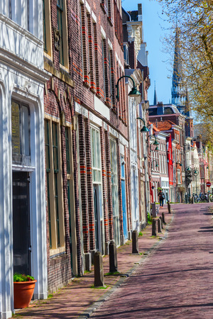 row of houses: typical row houses along a canal in Gouda, Netherlands