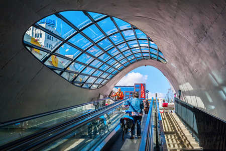 Eindhoven, Netherlands - April 12, 2016: escalator to a bicycle parking with unidentified people. With about 225,000 inhabitants its the 5th-largest municipality of the Netherlands