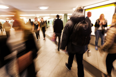 blur subway: people in motion blur walking in a subway station Stock Photo