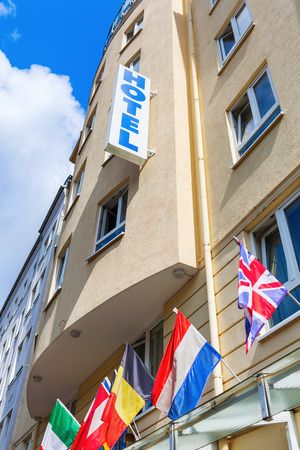 accomodation: facade of an European hotel with national flags Stock Photo