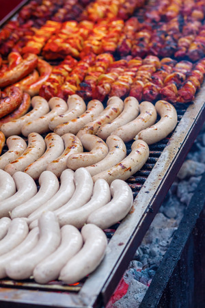 meat grill: bratwurst on a large grill Stock Photo