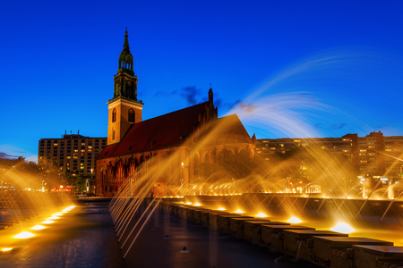 marys: St Marys Church in Berlin, Germany, with fountain in front at night
