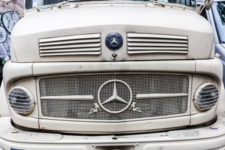 daimler: Berlin, Germany - May 17, 2016: front of a Mercedes Benz truck. Mercedes-Benz is a global automobile manufacturer and a division of the German company Daimler AG.