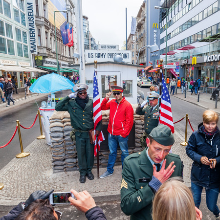 checkpoint: Berlin, Grmany - May 15, 2016: unidentified people at Checkpoint Charlie. Checkpoint Charlie was the best-known Berlin Wall crossing point between East Berlin and West Berlin, during the Cold War