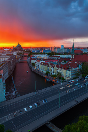 Berlin, Germany - May 14, 2016: Berlin at sunset. Berlin is capital of Germany and one of its 16 states. It has about 3.5 mio inhabitants and is a global city of culture, politics, media and sciences