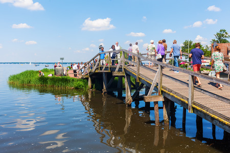 meer: Steinhude, Germany - June 05, 2016: Steinhuder Meer at Steinhude with unidentified people. With about 30 sq km it is the largest lake of northwestern Germany and it is a nationwide tourist destination Editorial