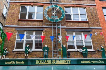 covent: London, UK - June 16, 2016: building at Neals Yard in London. Neals Yard It is a small alley in Covent Garden with colorful houses. It contains several health food cafes and values driven retailers