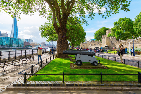 historic sites: London, UK - June 15, 2016: exterior view of the Tower of London with unidentified people. Tower of London is one of the worlds most famous fortresses, and one of Britains most visited historic sites Editorial