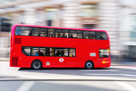 busses: London, UK - June 15, 2016: red double-decker bus in London in motion blur. The red busses are one of the main iconic symbols of London.