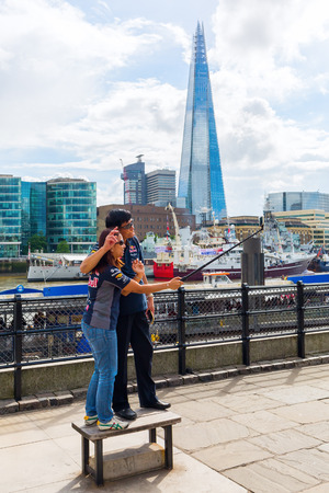 shard: London, UK - June 15, 2016: view over river Thames to The Shard with unidentified people. The Shard is with 310 meters the second largest building in Europe. Editorial