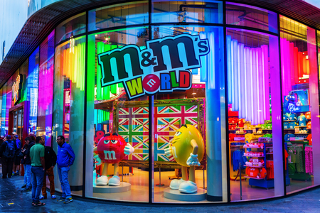 London, UK - June 19, 2016: M&M store with unidentified people. M&Ms originated in US in 1941, now sold in as many as 100 countries. More than 400 mio individual M&Ms are produced every day in the US