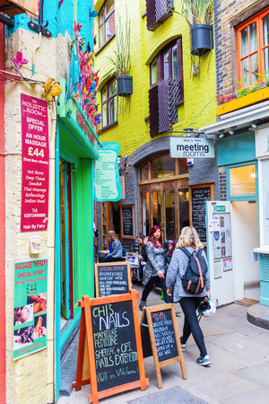 covent: London, UK - June 16, 2016: Neals Yard with unidentifed people. It is a small alley in Covent Garden with colorful houses. It contains several health food cafes and values driven retailers