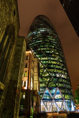 30 st mary axe: London, UK - June 17, 2016: 30 St Mary Axe at night. It is a commercial skyscraper in the City of London. It was completed in December 2003 and it is with 41 storeys 180 metres tall Editorial