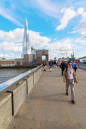 shard: London, UK - June 15, 2016: view from London Bridge to The Shard with unidentified people. The Shard is with 310 meters the second largest building in Europe.