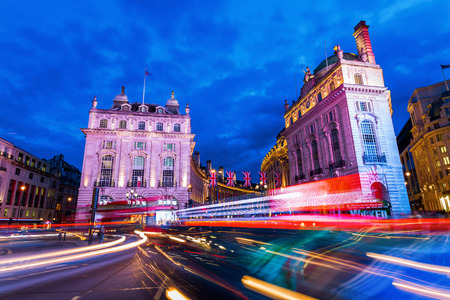 piccadilly: London, UK - June 15, 2016: Piccadilly Circus in London at night. Its status as a major traffic junction has made Piccadilly Circus a busy meeting place and tourist attraction