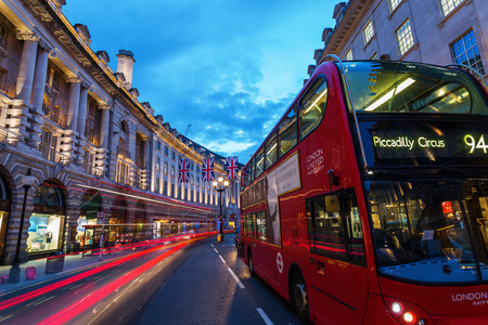 west end: London, UK - June 15, 2016: Regent Street in London at night. Regent Street is one of the major shopping streets in the West End of London,