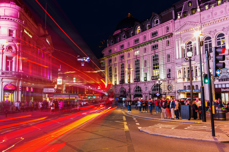 piccadilly: London, UK - June 18, 2016: Piccadilly Circus in London at night. Its status as a major traffic junction has made Piccadilly Circus a busy meeting place and tourist attraction